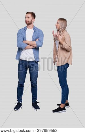Couple Having A Fight. Girl Screaming At Man. Girl Is Not Satisfied. Couple Standing Isolated. Man D