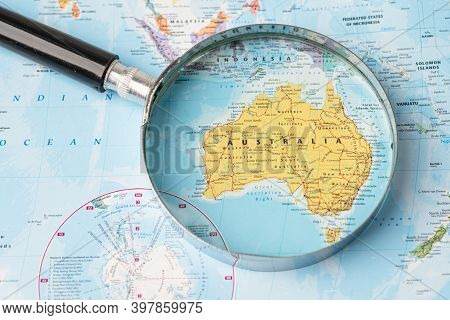 Bangkok, Thailand - November 01, 2020 Australia, Magnifying Glass Close Up With Colorful World Map