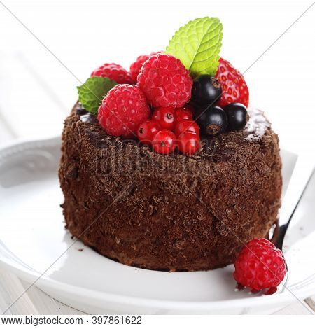 Layer The Chocolate Cake On A White Plate With Fresh Lychee Strawberries. Homemade Bakery Concept. G