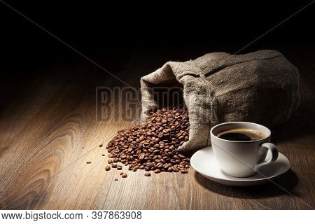 A Cup Of Coffee On A Cup. Black Americano Coffee. Coffee Cup With Coffee Bean Background. Great Coff