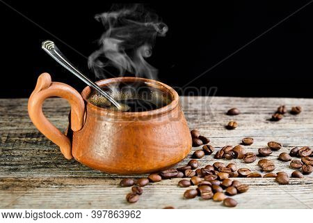 A Cup Of Coffee On A Cup. Black Americano Coffee. Coffee Cup On Wooden Background. Hot Coffee.