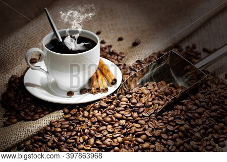A Cup Of Coffee On A Plate. Black Americano Coffee. Coffee Cup On Wooden Background. Hot Coffee.