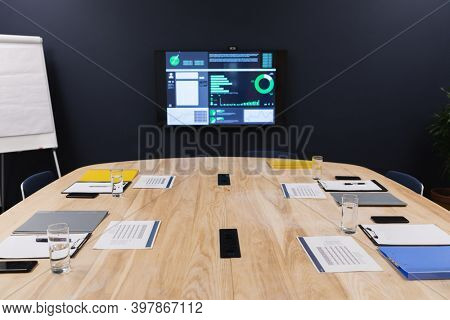 Conference room statistics displayed on monitor prepared for meeting. creative office business meeting brainstorming space.