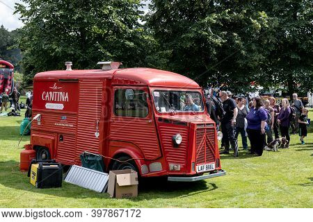 Banchory, Scotland - August 10, 2019: Red Legendary French Citroen Type H Van In A Green Park Provid