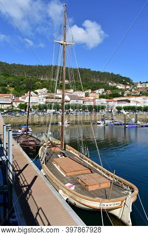Muros, Spain. June 18, 2020. Fishing Village With Old Traditional Wooden Sailing Boats Moored In The