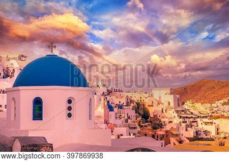 Oia Town, Santorini Cyclade Islands, Greece. Beautiful Sunset With A Rainbow Over The Vilage Of Ia.