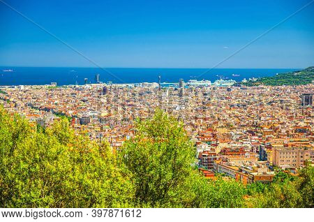 Aerial Panoramic View Of Barcelona City Historical Quarters Districts With Mediterranean Sea And Cle