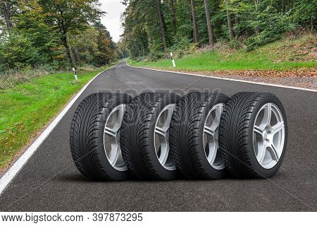 Car Wheels Set - Four Car Wheels Arranged In A Row On The Asphalt Road Next To The Forest - 3d Illus