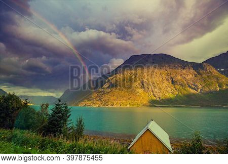 Sunset Over The Sea With Dramatic Sky. Beautiful Fjord In Evening. Rainbow On The Cloudy Sky