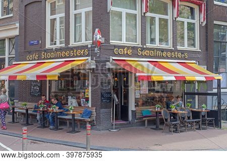Amsterdam, Netherlands - May 16, 2018: Cafe Staalmeesters At Street Corner In Amsterdam, Holland.