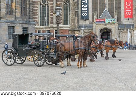 Amsterdam, Netherlands - May 18, 2018: Horse Drawn Carriage At City Square In Amsterdam, Holland.