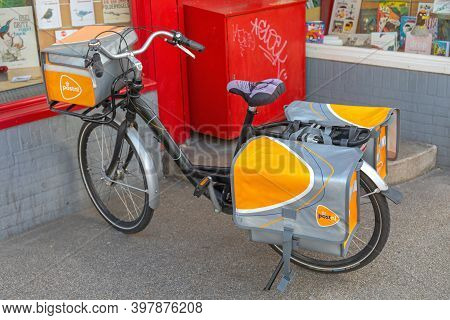 Amsterdam, Netherlands - May 16, 2018: Post Nl Postman Cargo Bicycle With Panniers In Amsterdam, Hol