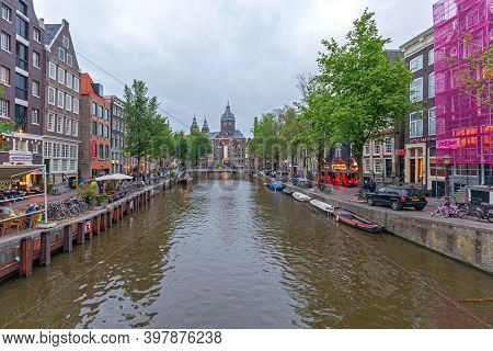Amsterdam, Netherlands - May 18, 2018: Famous Red Light District Tourist Attraction In Amsterdam, Ho