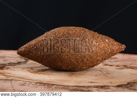 Kibe Roast On The Wooden Table With Black Background