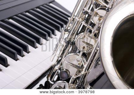Saxophone And Piano Keys