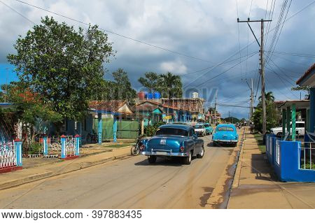 Cuba, November 2017 - Old Vintage American Car. Street Urban Scene With Old Car And Colorful Cuban H