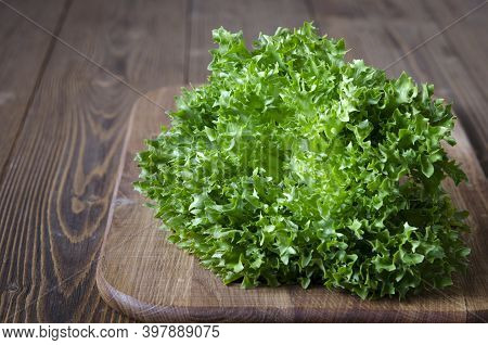 Bunch Of Green Lettuce On Wooden Board