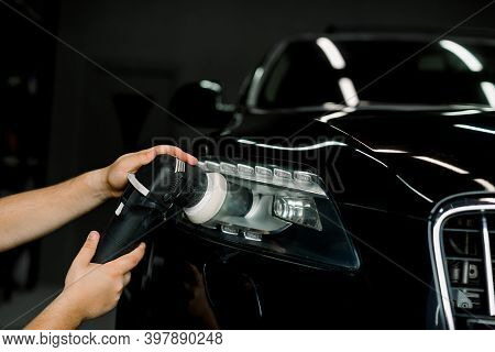 Car Wax Polishing Process. Cropped Image Of Hands Of Male Professional Worker With Orbital Polisher
