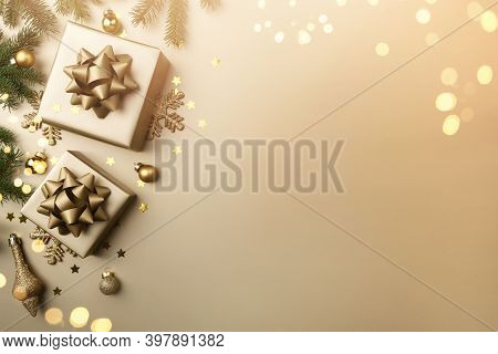 Merry Christmas Card Made Of Golden Christmas Gift Boxes With Bows On Gold Background. Xmas And New