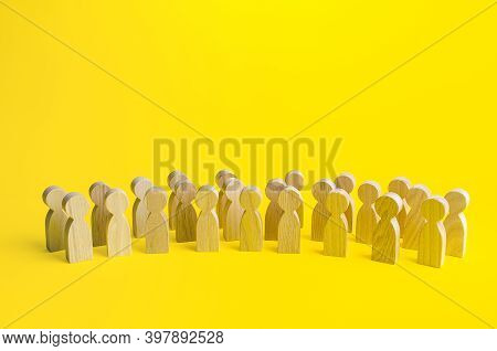 A Large Group Of Figurines Of People On A Yellow Background. Social Survey And Public Opinion, Elect