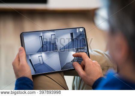 Cctv Security Camera Surveillance Video Footage On Tablet