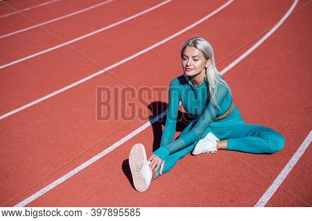 Stretching Exercises. Female Athlete Ready For Sport Workout. Trainer Or Coach Training. Perfect Bod