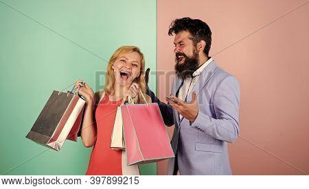Consumerism Addictive Behavior. Couple In Mall. Shopaholic Girlfriend. Black Friday Concept. Woman O