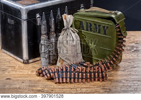 Still Life Of Military Armament, Weapon And Cartridges On Wooden Background