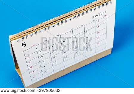 Close Up May 2021 Calendar Desk For Organizer To Plan And Reminder On Blue Background.