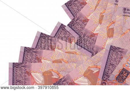 500 Sri Lankan Rupees Bills Lies In Different Order Isolated On White. Local Banking Or Money Making