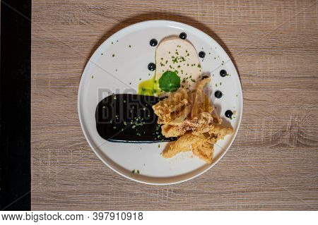 Crispy Calamari With White Taramas Cream And Ink Sauce Chef Daniel Krbasian