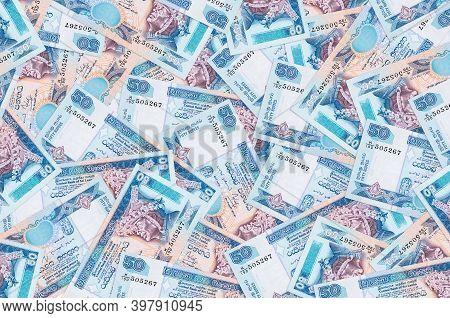 50 Sri Lankan Rupees Bills Lies In Big Pile. Rich Life Conceptual Background