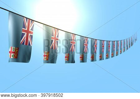 Pretty Day Of Flag 3d Illustration  - Many Fiji Flags Or Banners Hanging Diagonal On Rope On Blue Sk