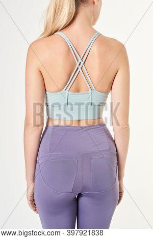 Blonde woman wearing a sports bra mockup with criss cross strap