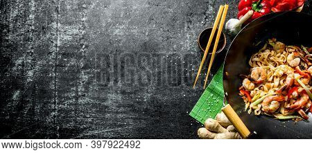 Delicious Chinese Udon Noodles With Shrimp, Sauce And Vegetables. On Dark Rustic Background
