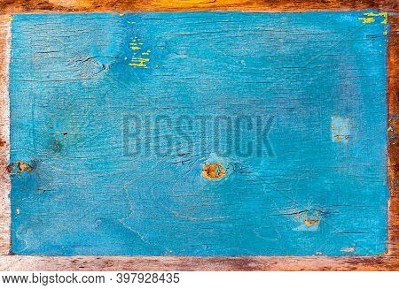 Faded Texture Of A Wooden Surface Painted In Blue. Peeling Blue Paint. Bough Of A Tree. Wood Plywood