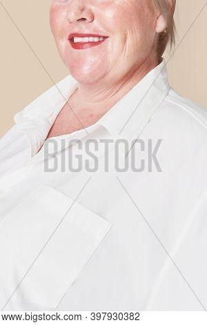 Size inclusive women's fashion white shirt studio shot