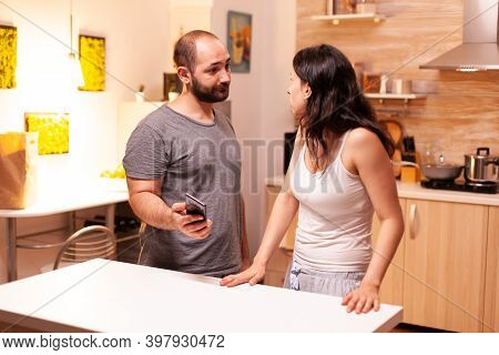 Jealous Husband Asking For Explanations After Checking Wifes Phone. Cheated Angry Frustrated Irritat