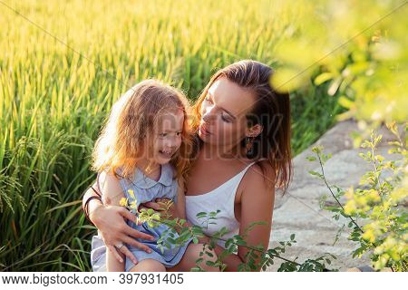Young Mother And Daugther Hug Near Rice Field, Nature, Travel