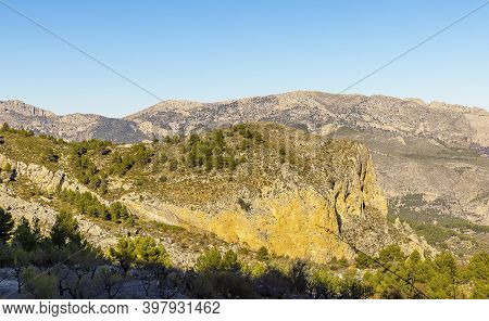 Scenic Mountain View Of Landscape With Blue Sky. Hiking Destination, Aitana Mountain Massif In Spain