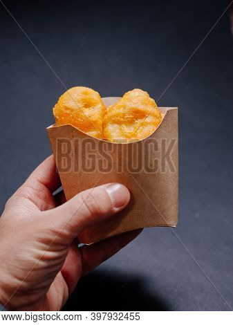 A Man's Hand Holds A Paper Box Without Logo With Chicken Nuggets. Chicken Nuggets In A Paper Box Wit