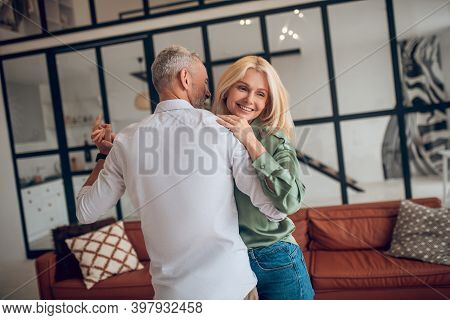 Nice Couple Dancing In The Room And Looking Happy