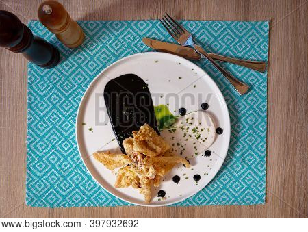 Crispy Calamari With White Cream And Ink Sauce