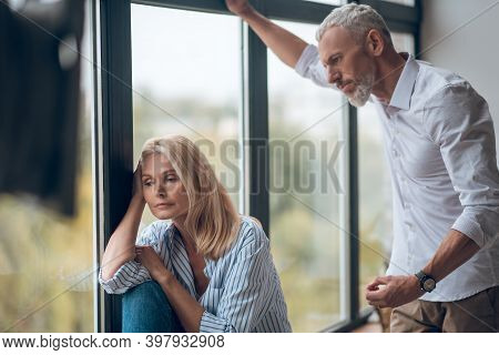 Married Couple Having Hard Conversation And Looking Upset