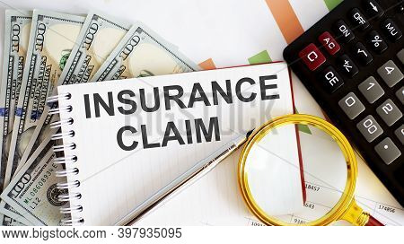 Word Writing Insurance Claim . Business Concept With Chart, Dollars And Office Tools