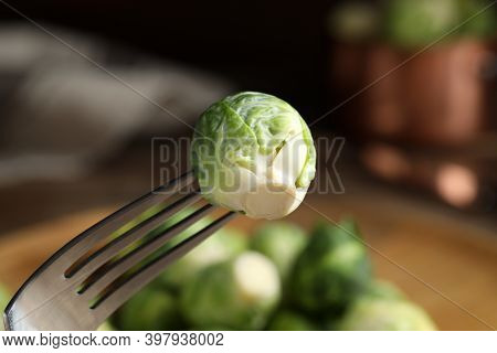 Fresh Brussels Sprout On Fork, Closeup View