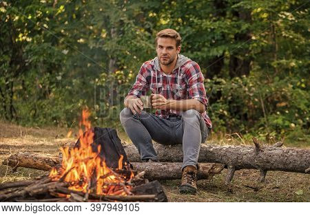 Man Relaxing In Park. Hiking Adventure. Picnic In Tourism Camp. Drink Coffee At Picnic Campfire. Get