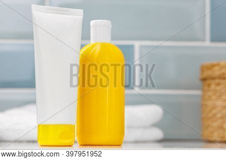 Sunscreen Cosmetic Containers In Bathroom Close Up