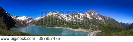 Panorama Of The Beautiful Austrian Dam Stausee Mooserboden Overlooking The Kaprun Glacier. The Monst