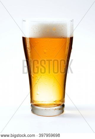 Fresh beer in a pint on white background
